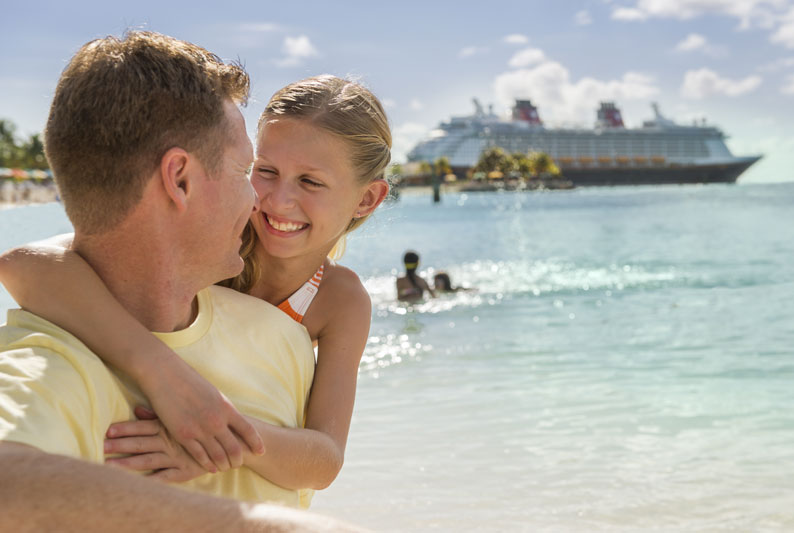 Father and daughter vacationing at Disney's Castaway Cay on a Disney Cruise Line Vacation booked by Main Street Magic, LLC., a no-fee travel agency specializing in Disney vacation planning   Authorized Disney Vacation Planner
