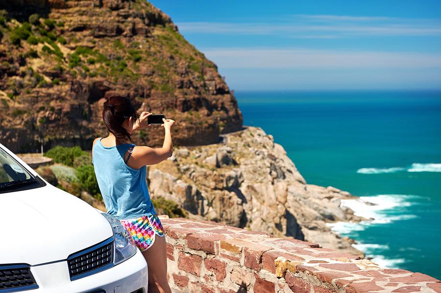 bigstock-Tourist-woman-taking-a-photogr-41915188