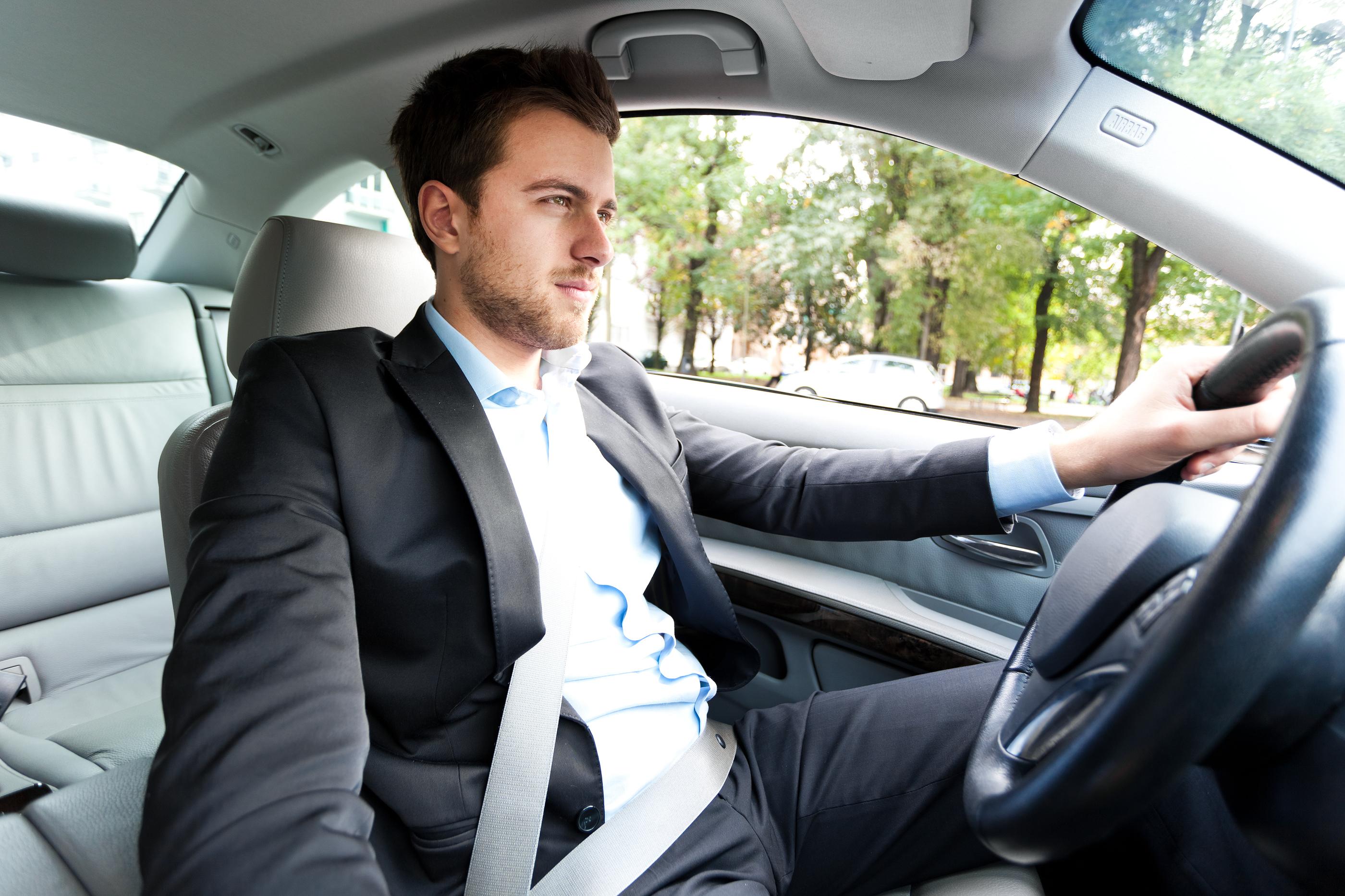 bigstock-Man-driving-his-car-38741980