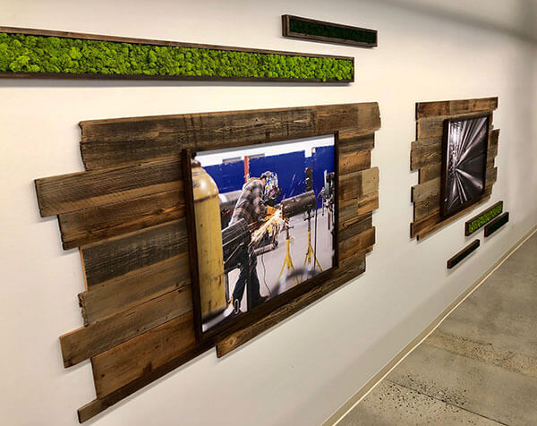Living wall, reclaimed wood, moss, custom logo, brand sign, moss covered logo, vertical wall garden, corporate signage, framed prints for office, office design, interior design, rustic frames, custom signage, brand signs