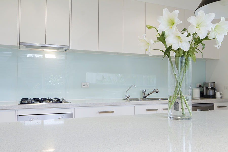 Painted white glass splashback