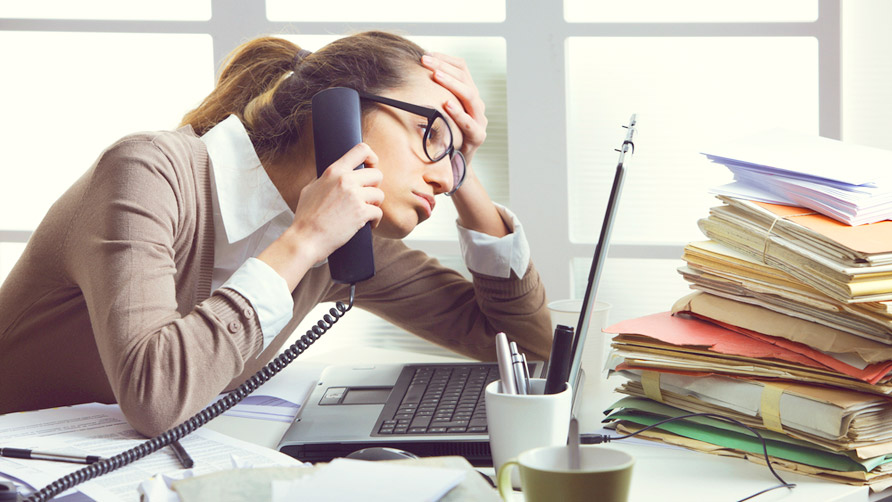 a-stressed-business-woman-looks-tired-she-answer-telephones-in-her-office