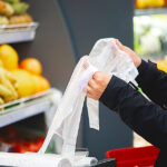 woman shopping with a plastic bag