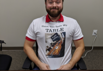 Doug sporting a tshirt with a picture of the infamous conference room table in orlando - nelson & company llc