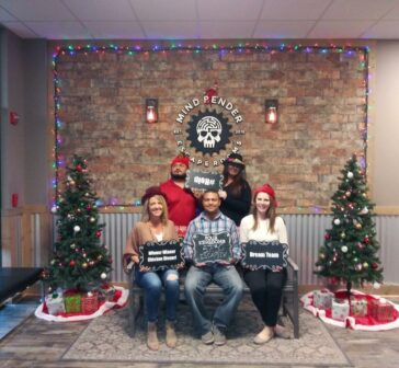 Erika Nelson and her winning mindbender escape room team - nelson & company llc