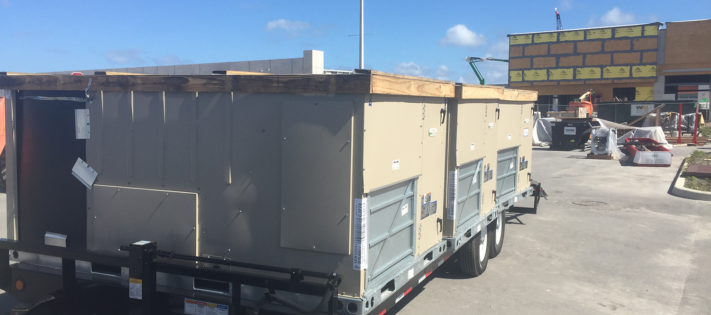 new hvac equipment being delivered on the job - nelson & company llc
