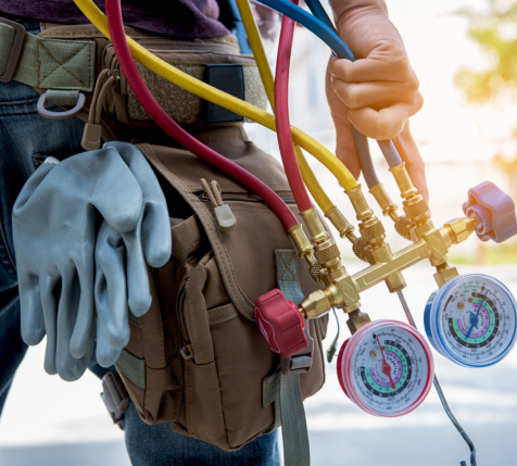 worker carrying a set of hvac air gauges - nelson & company llc