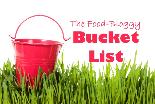 The bucket on green grass isolated on white background