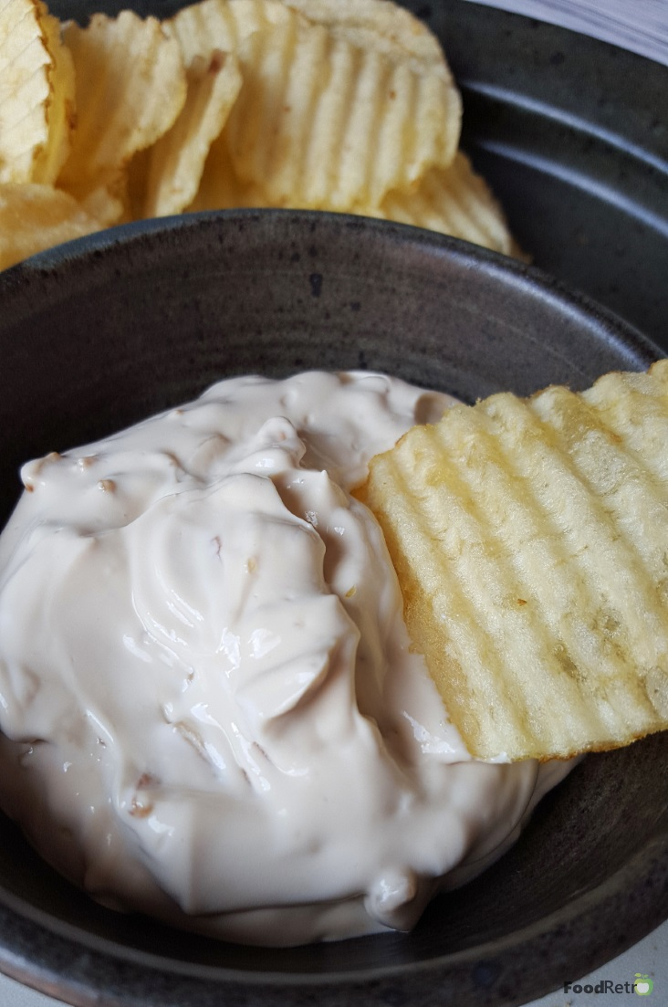 Superbowl woes? My Super Simple Sour Cream and Onion Dip will keep your stress level down. Trust me, it's way better than the stuff you buy in a can, and it's two ingredients and a swirl of a spoon. It barely takes more time than buying the stuff pre-made. | FoodRetro.com | #BornOnTheFarm