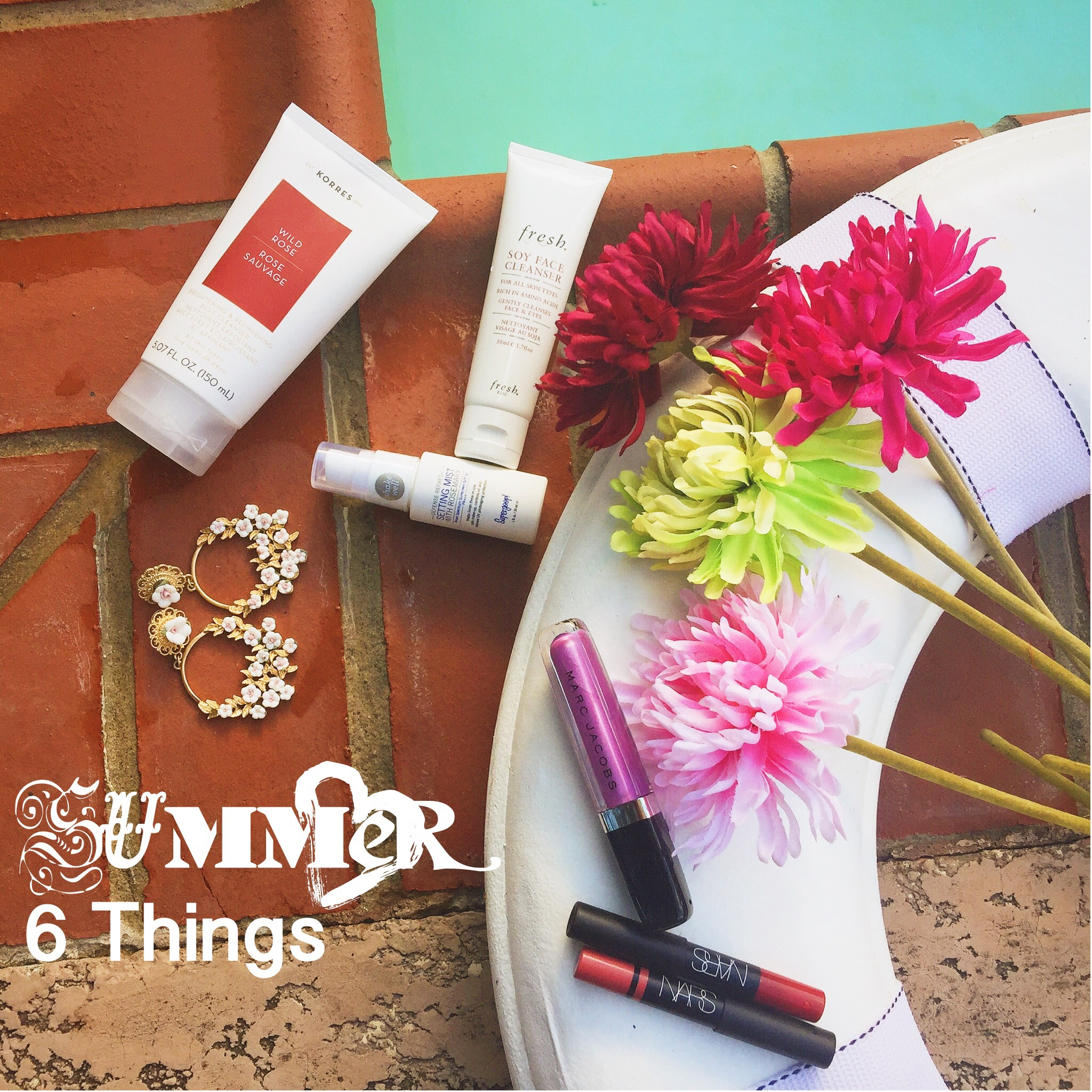 Beauty products and tips for spring and summer featuring korres rose cleanser, fresh soy cleanser, aldo flower earrings, supergoop spf setting mist, nars red lipstick cruella, marc jacobs beauty lip gloss