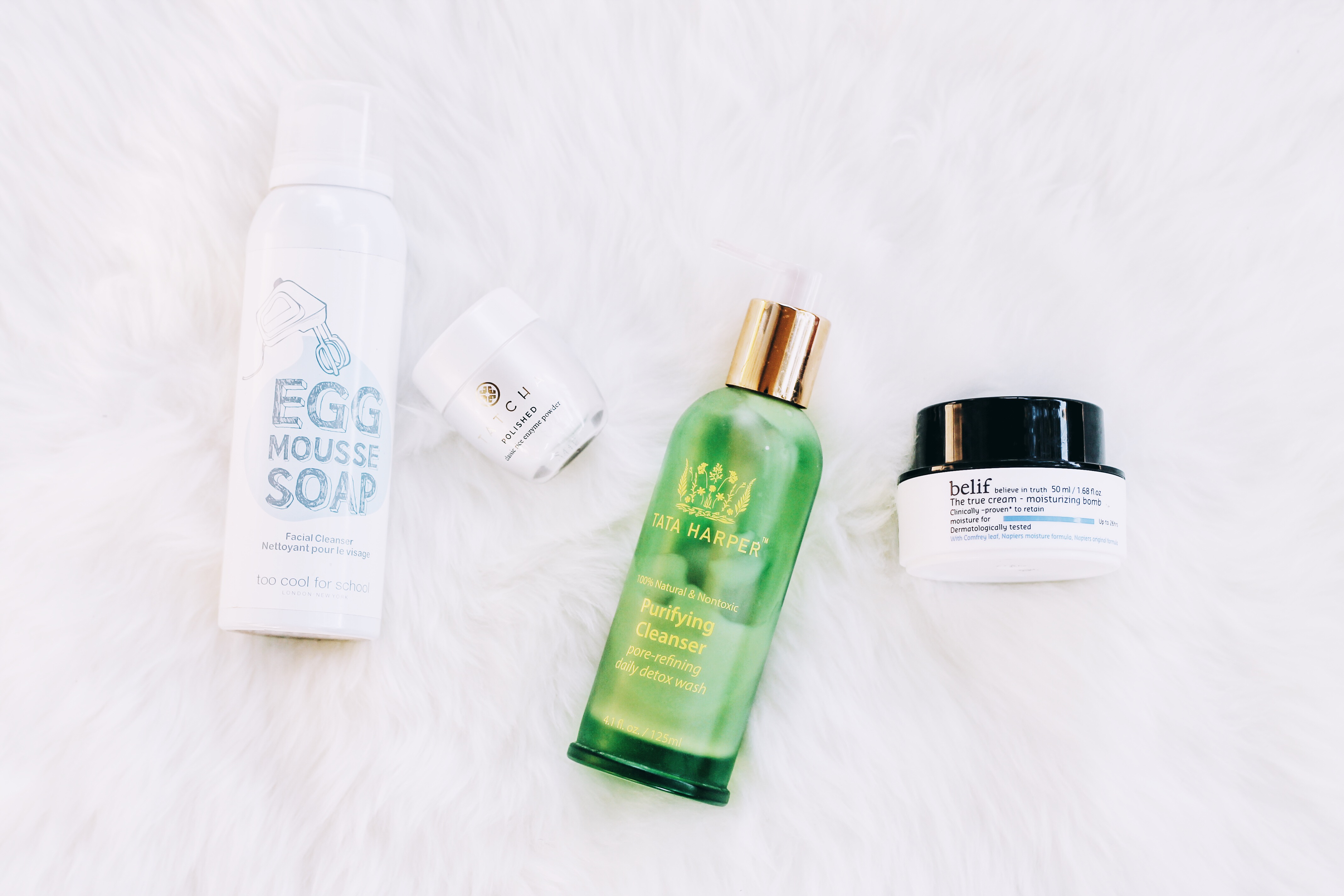 Belif The True Cream Aqua Bomb, Too Cool For School Egg Mousse Soap Facial Cleanser, Tata Harper Purifying Cleanser, Tatcha Polished Classic Rice Enzyme Powder