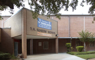 Front entrance of TH Rogers Houston ISD via Texas Land Surveying