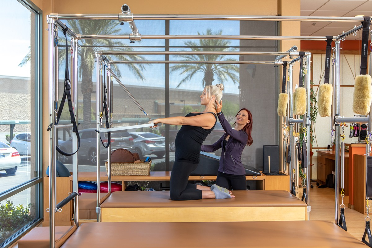 Prenatal Pilates on the Cadillac thigh strech with back extension