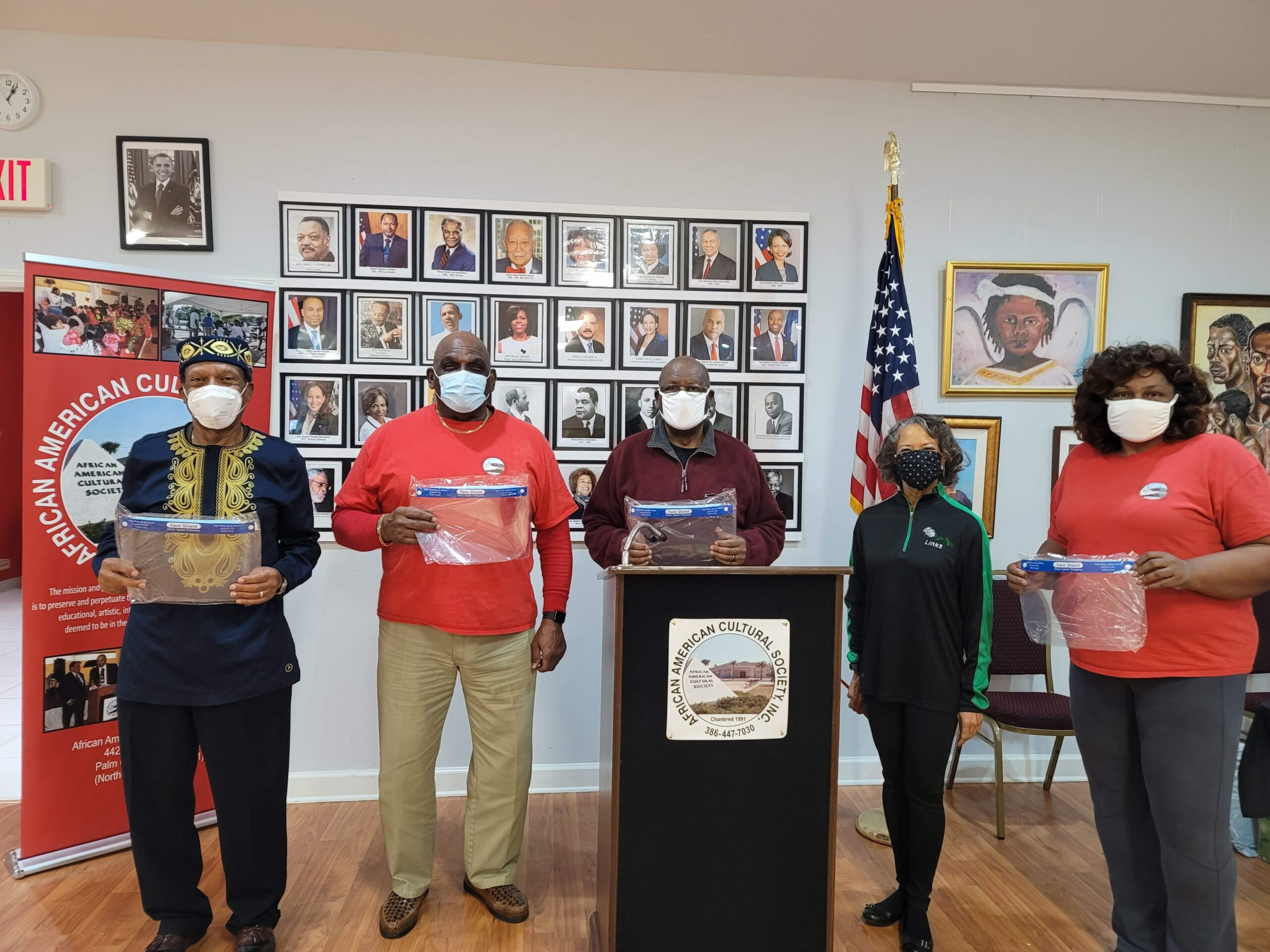 The Links Incorporated presents Covid-19 protection face shields to the AACS