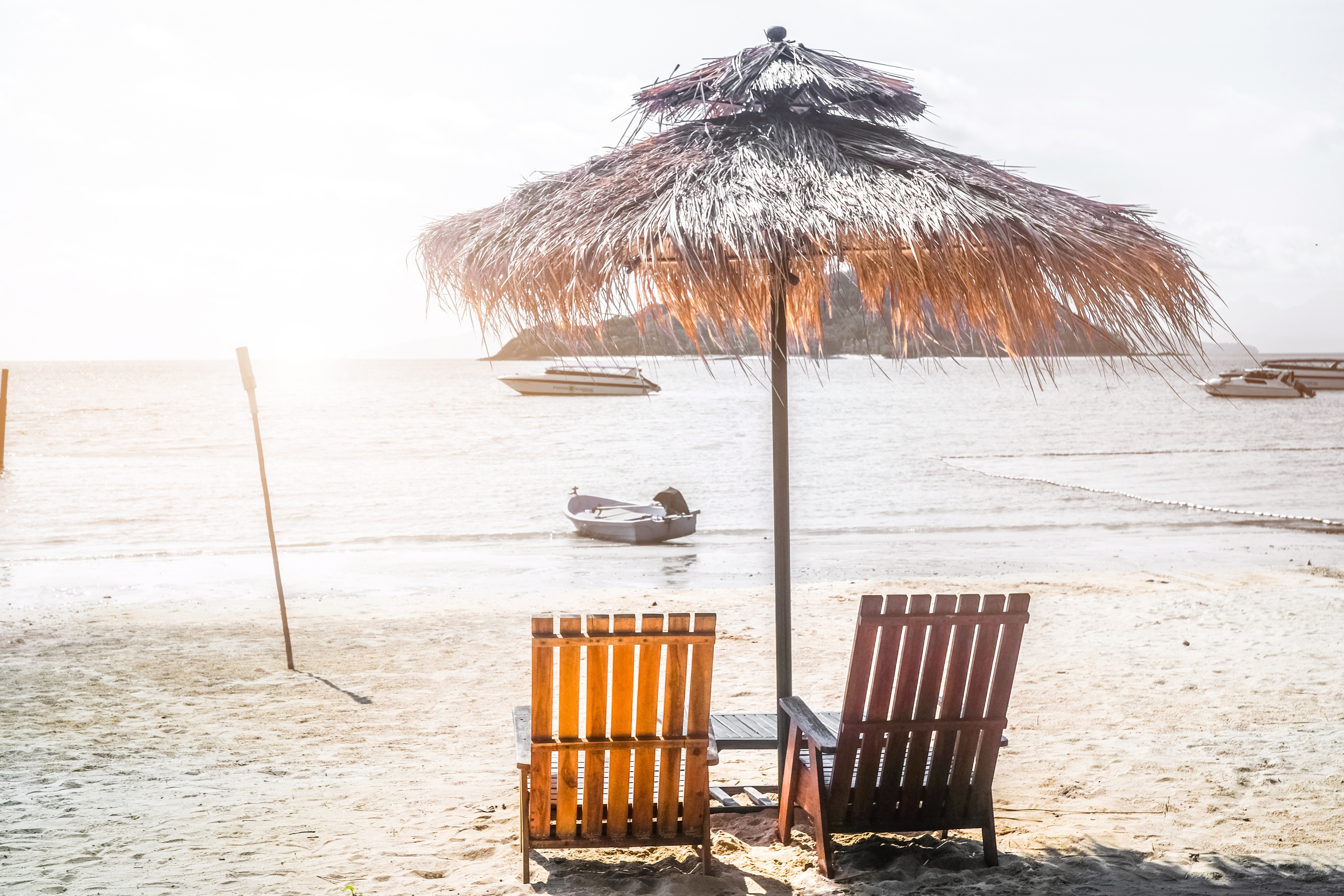 Vacation in tropical countries. Beach chairs and umbrella on the beach