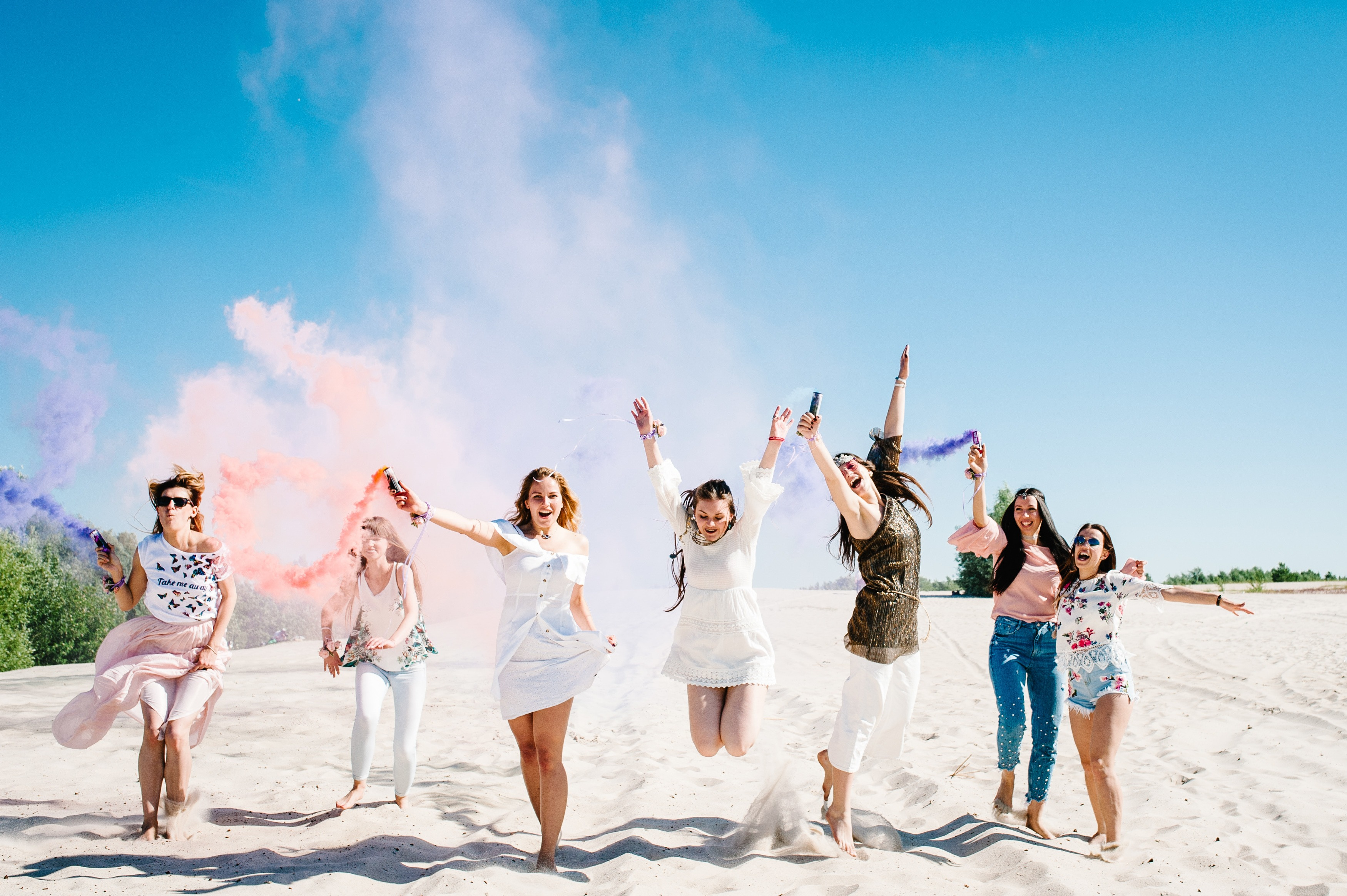 8 women celebrating on the beach this is a bridal party