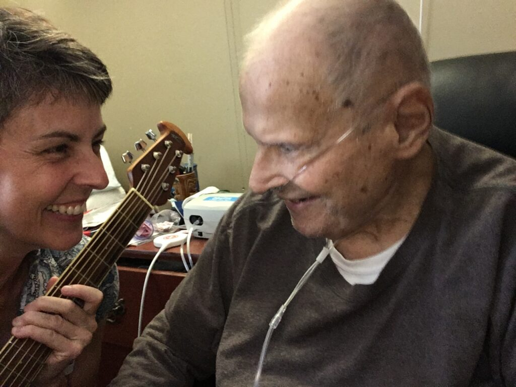 Jen Conley with music therapy client
