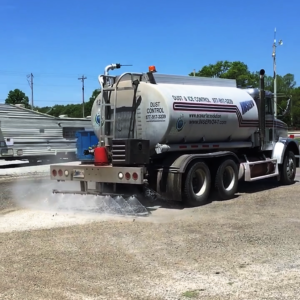 Dust Control truck spraying magnesium chloride on dirt to control dust