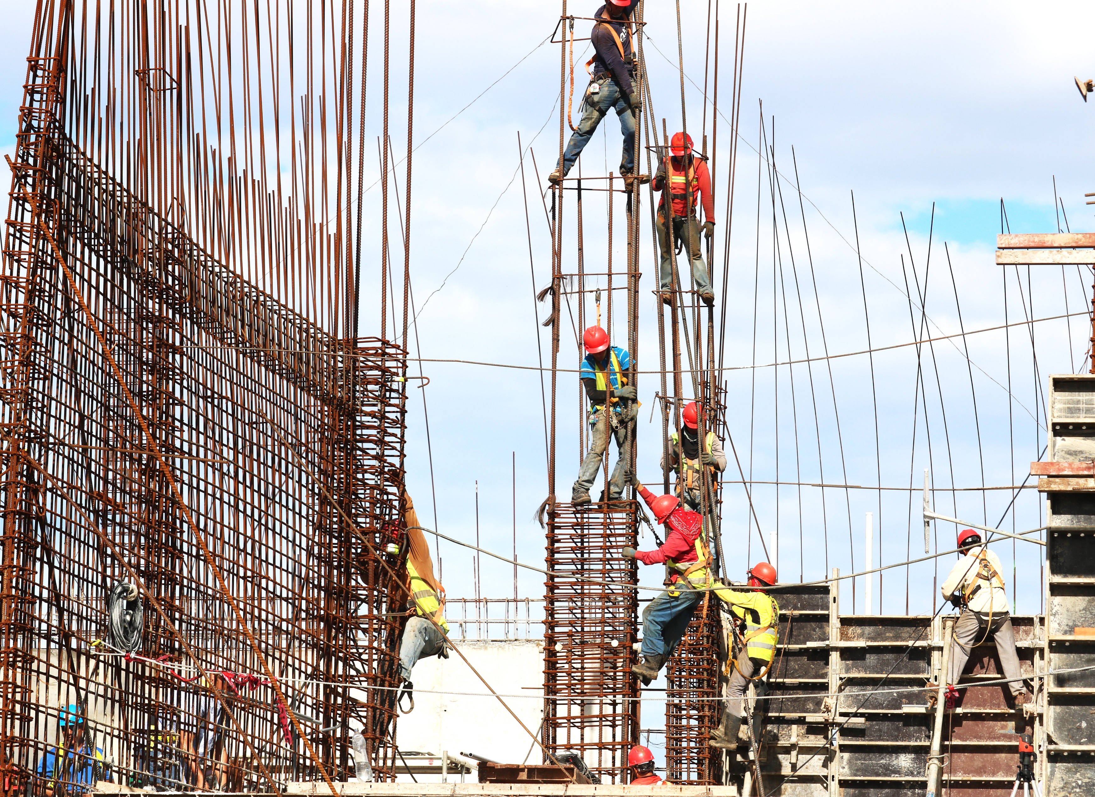 Construction Workers working on rebar on a construction site