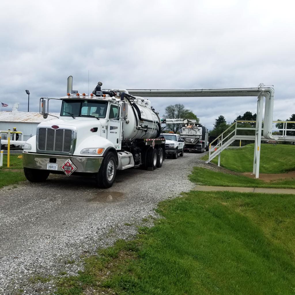 INSERV, Inc. Trucks on Site