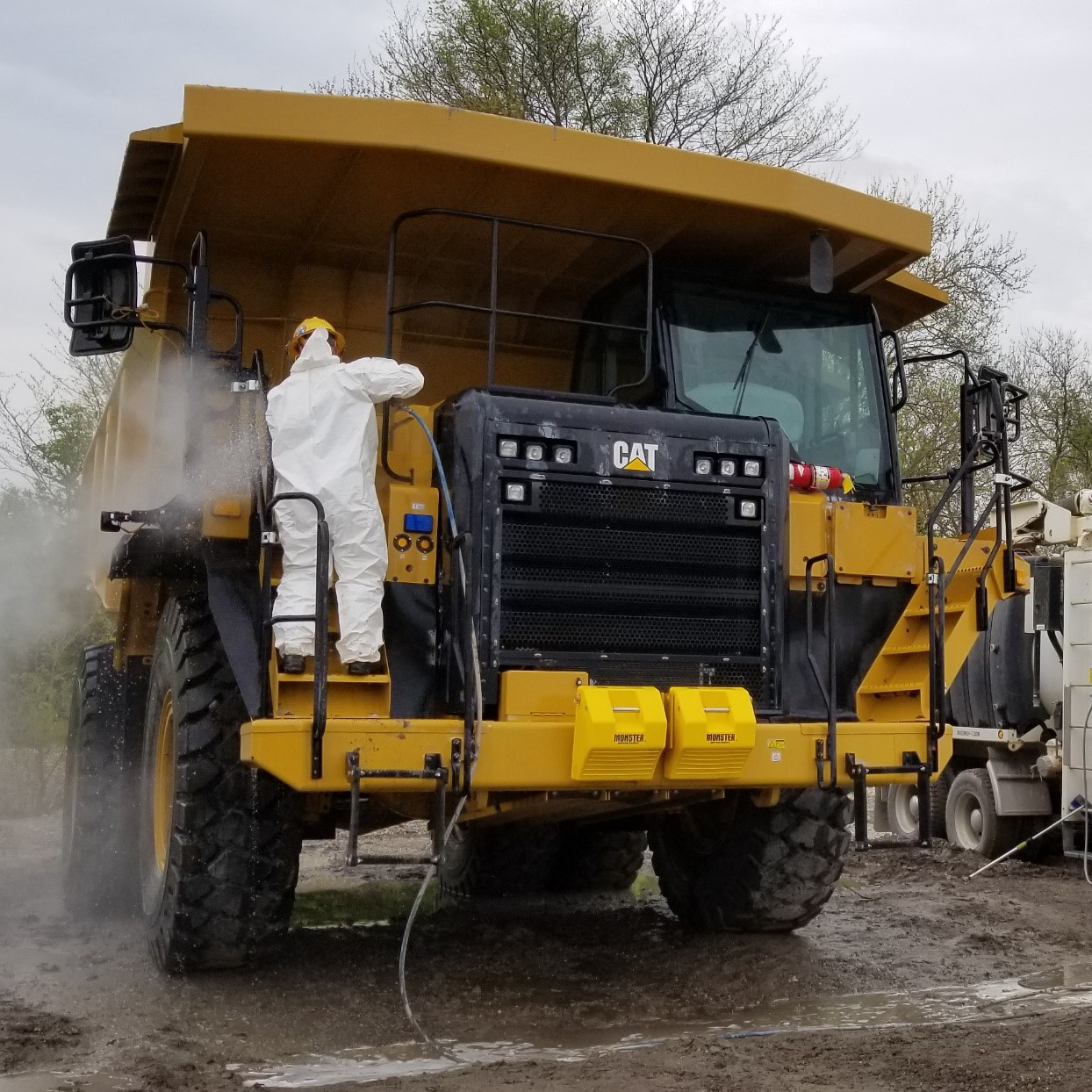 Steam cleaning heavy equipment
