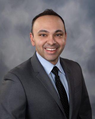 Neil M Kumar