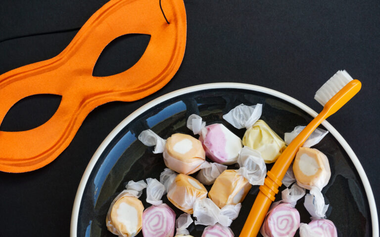 Bowl of Halloween Candy With Mask And Toothbrush