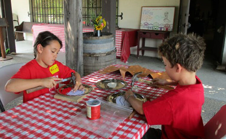 2 kids doing crafts at Wild West Camp