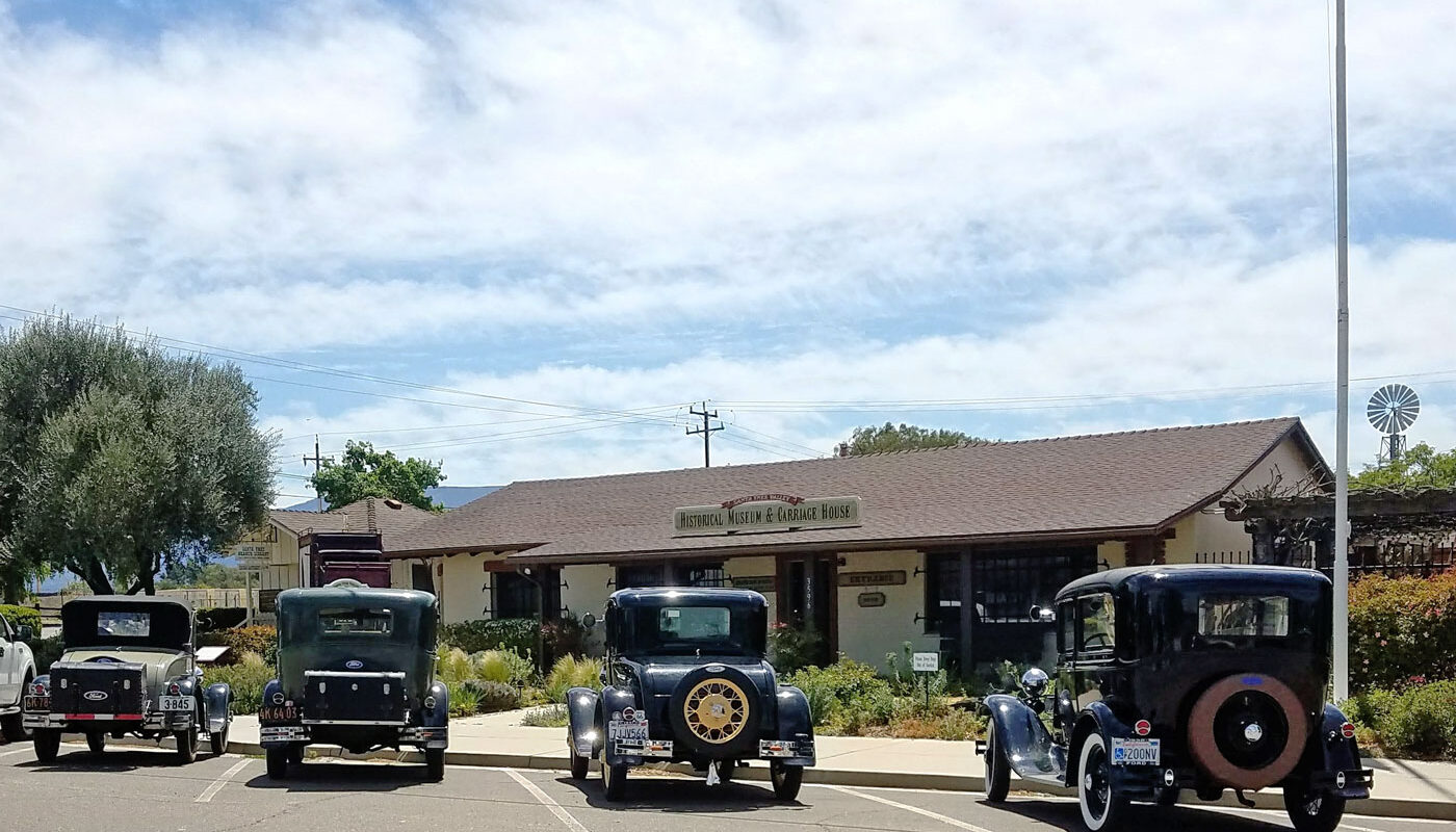 Santa Ynez Valley Historical Museum with antique cars parked in front