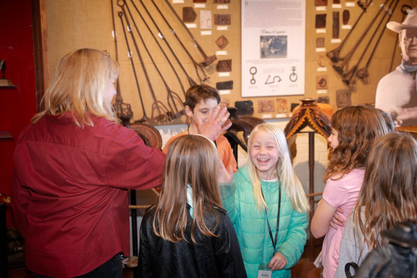 group of kids enjoying a tour of the museum