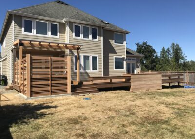 Outdoor deck with privacy screen