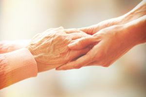 Baby Boomers, Woman caring for elderly
