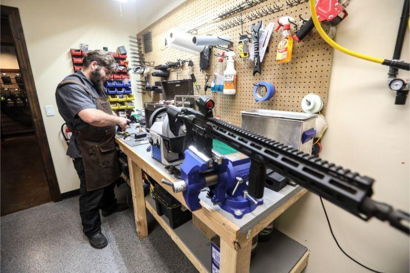 Timberline Firearms employee cleaning a gun.