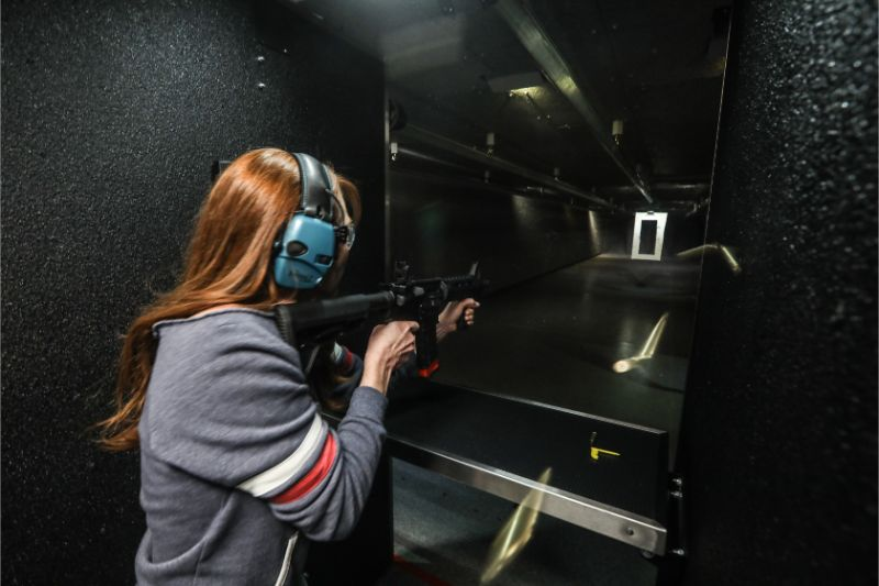Woman shooting AR15 at Timberline Firearms.