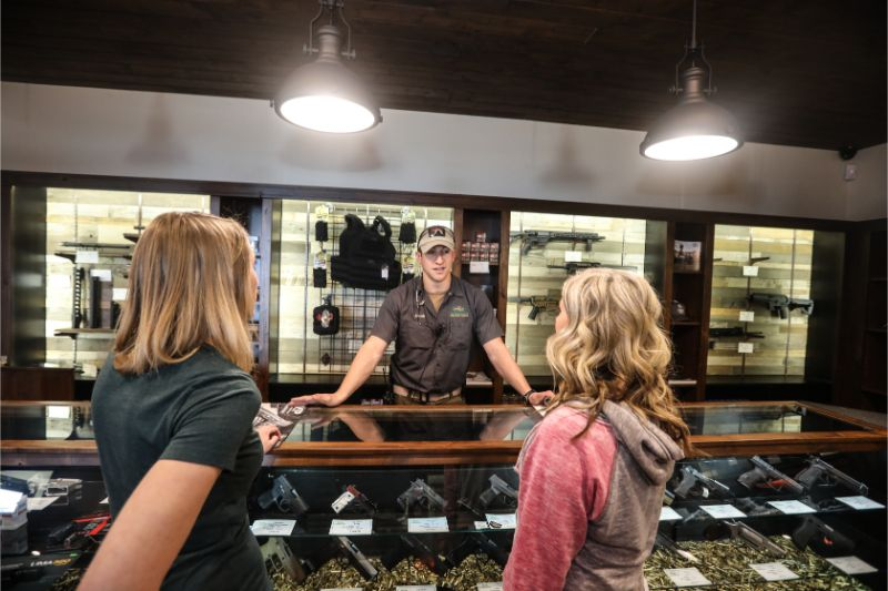 Timberline Firearms worker selling guns to visitors.