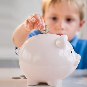boy-with-piggy-bank-teaching-kids-about-money-pg-full