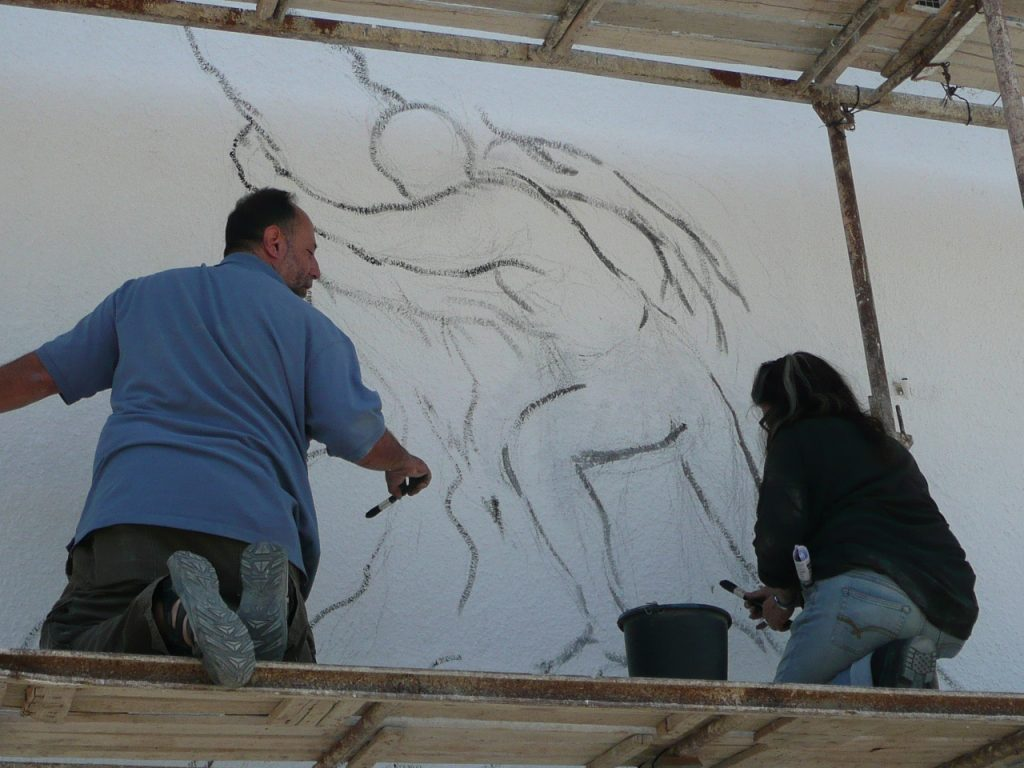 Susan Greene and John Halaka working out the design.
