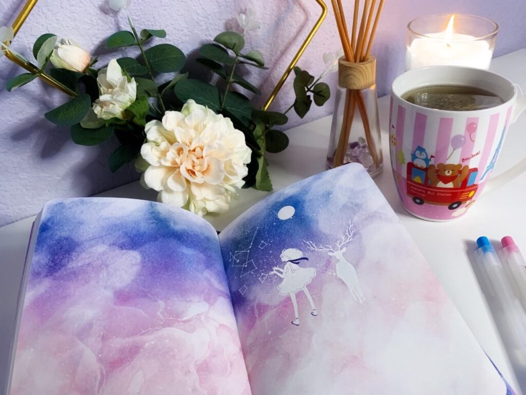 a productive night - self care with a journal, some tea, a candle, and some cute decor!