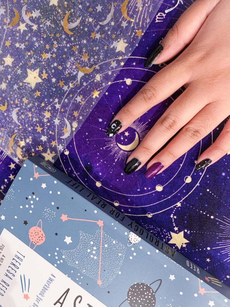spooky themed nails stars and moon