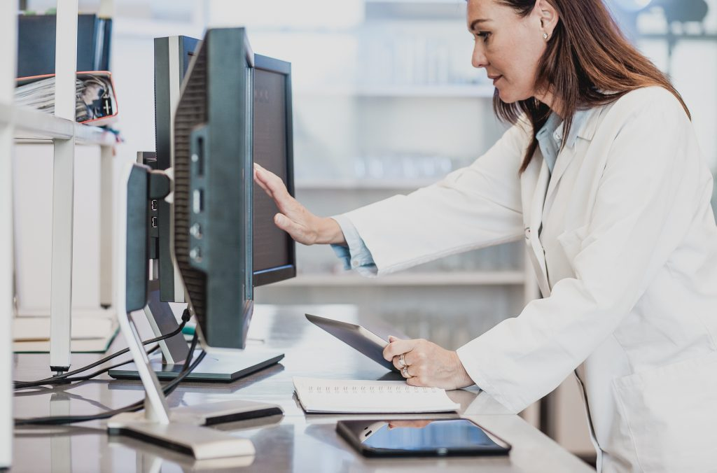 Scientist Working in The Laboratory, using computer