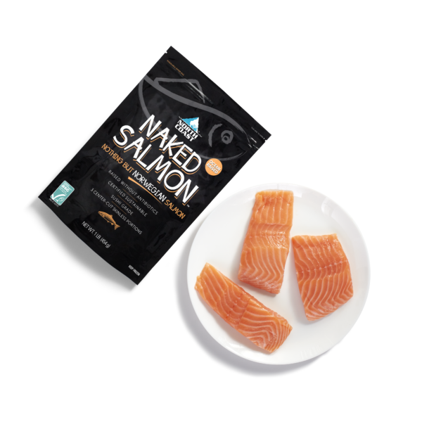 North Coast Naked farm raised Norwegian salmon in a one pound black retail bag with 3 5 ounce fresh salmon portions on a plate.