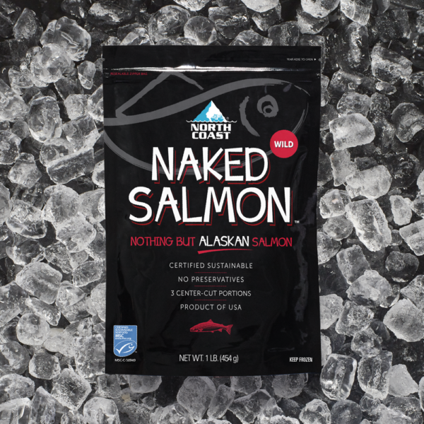 Certified sustainable North Coast Naked wild Alaskan salmon in one pound black retail bag on a bed of ice.