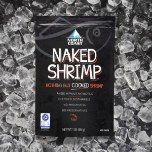 Certified sustainable cooked Naked Shrimp in a one pound black retail bag sitting on a bed of ice.