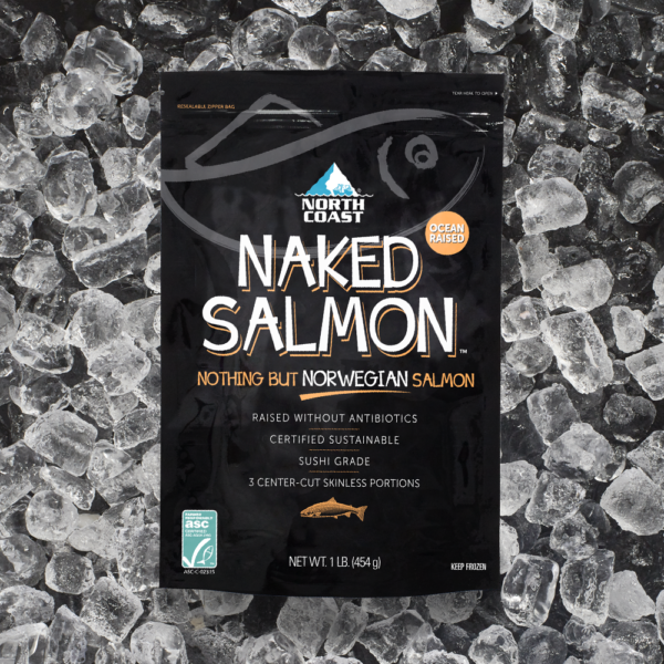 Certified sustainable North Coast Naked Norwegian salmon one pound black retail bag on a bed of ice.