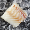 Fresh Naked wild Atlantic cod 5 ounce portion on a bed of ice.