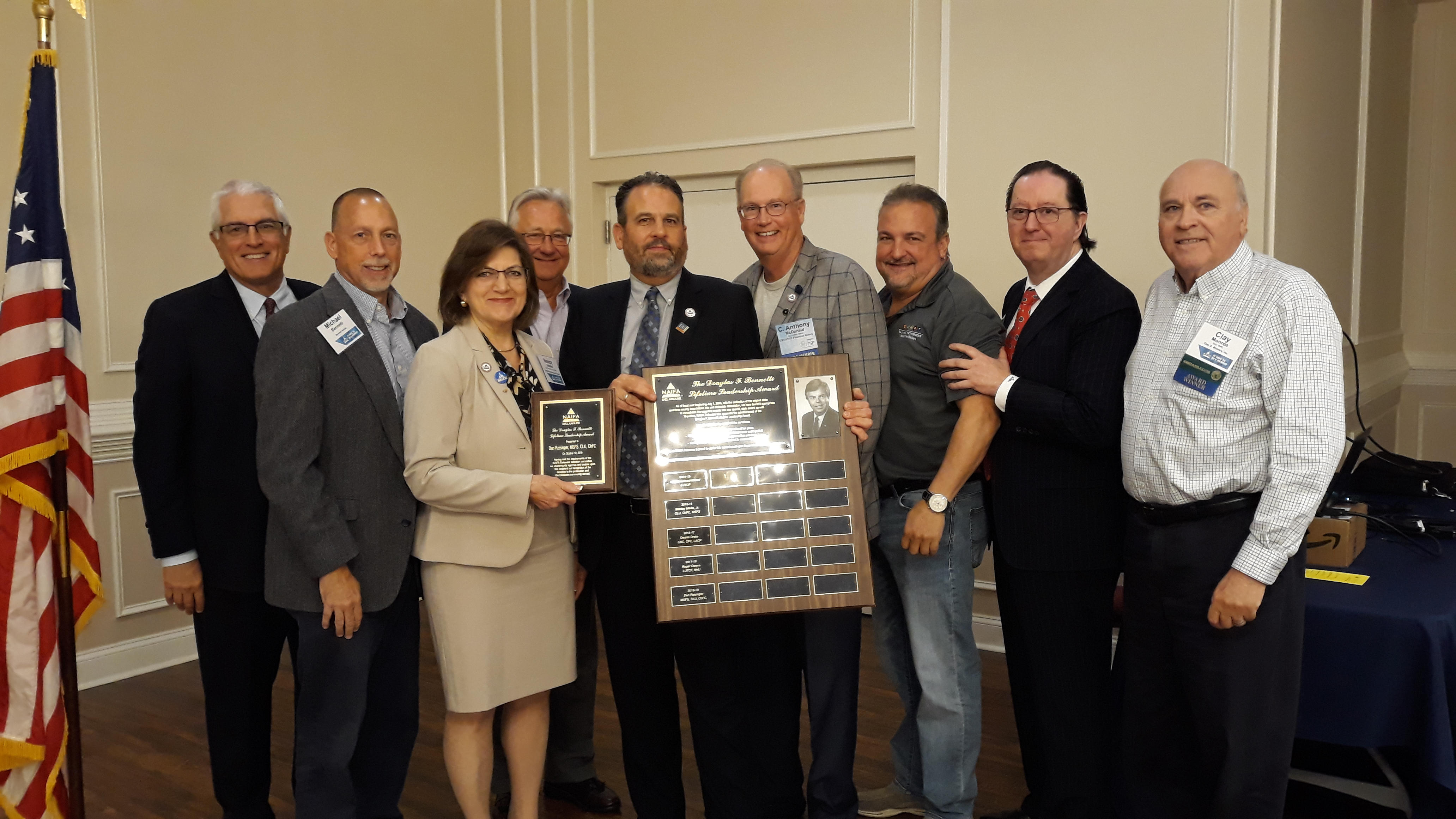 Dan Reisinger is presented the Bennetti Award. Taken with previous recipients in attendance.