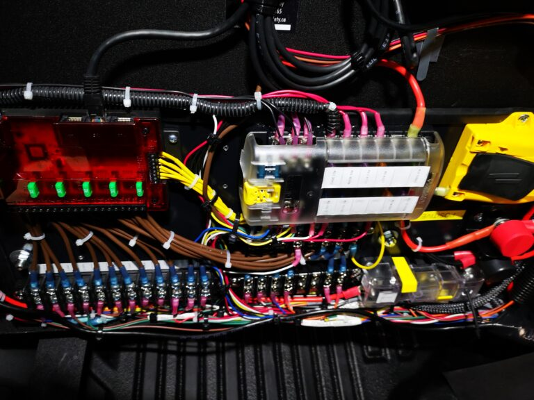 Our custom electronics bored full of products from BlueSea Systems and Feniex Industries