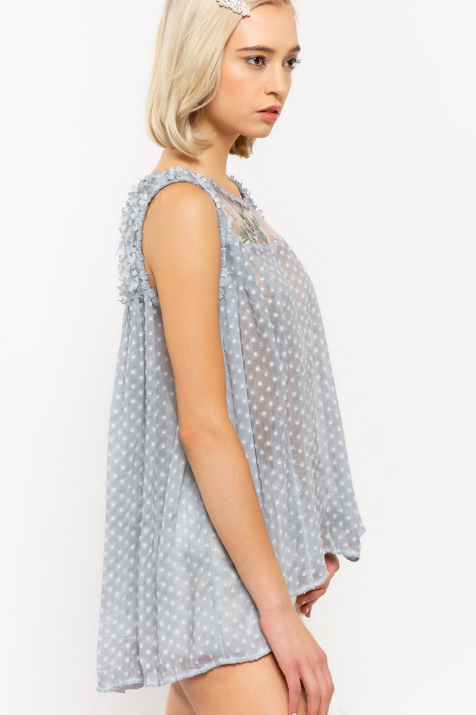 Sleeveless Floral Top with Mesh Front and Pleated Back Cascade Side
