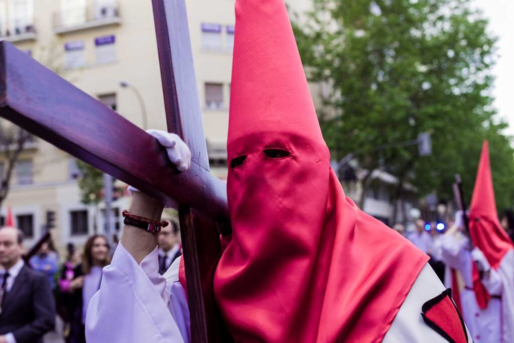 Easter tradition in Spain, costaleros carrying crosses