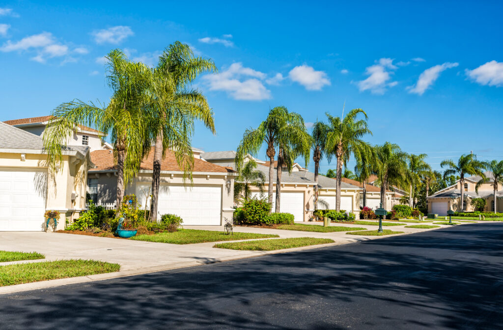 Gated community houses with palms in South Florida, United States